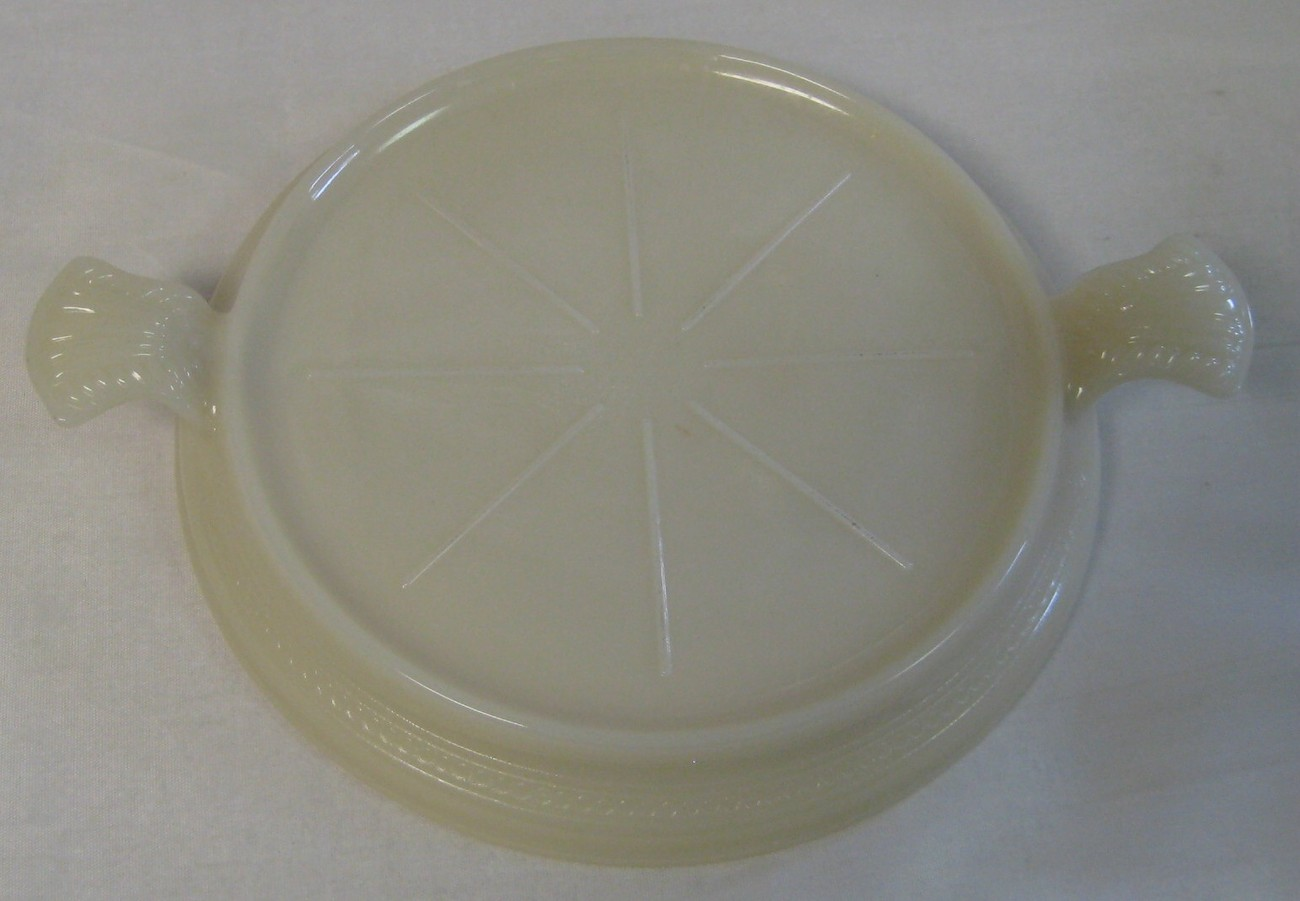 Anchor hocking fire king ivory philbe trivet hot plate