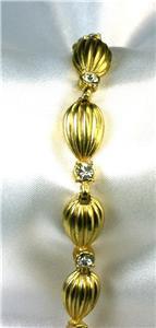 Pretty Rhinestone Bracelet w/Fluted Goldtone Egg Links