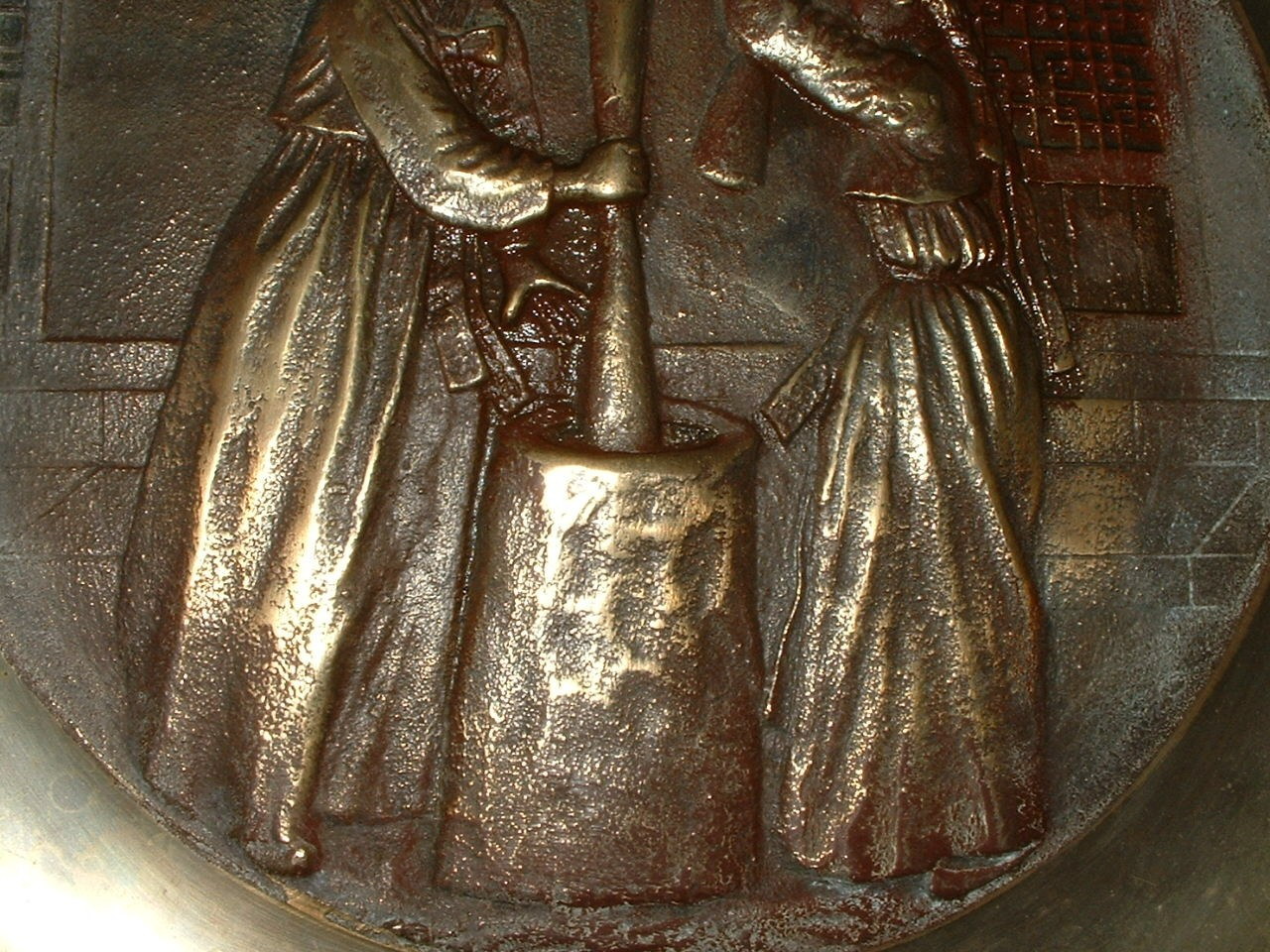 Vintage Heavy Brass Wall Hanging Women Making Butter