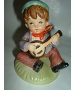 Vintage Ceramic Child Figurine Playing a Banjo - $12.00