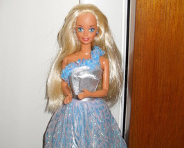 Barbie Doll Wearing Blue and Silver Dress - $5.99