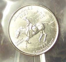 1999-P Delaware State Quarter MS65 in the Cello #629 - $2.39