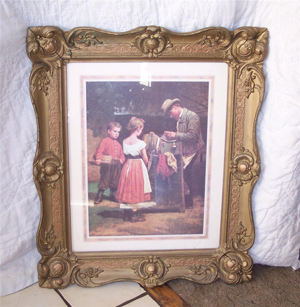 Gold Carved Frame w/ Picture of Girl and Boy
