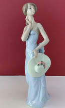 """NEW LLADRO FIGURINE """"COQUETTE"""" #5599 GIRL HOLDING HAT WITH FLOWERS 8.5"""" ... - $199.99"""