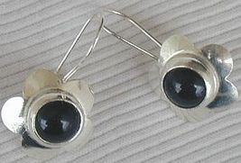 Black flowers earrings - $20.00
