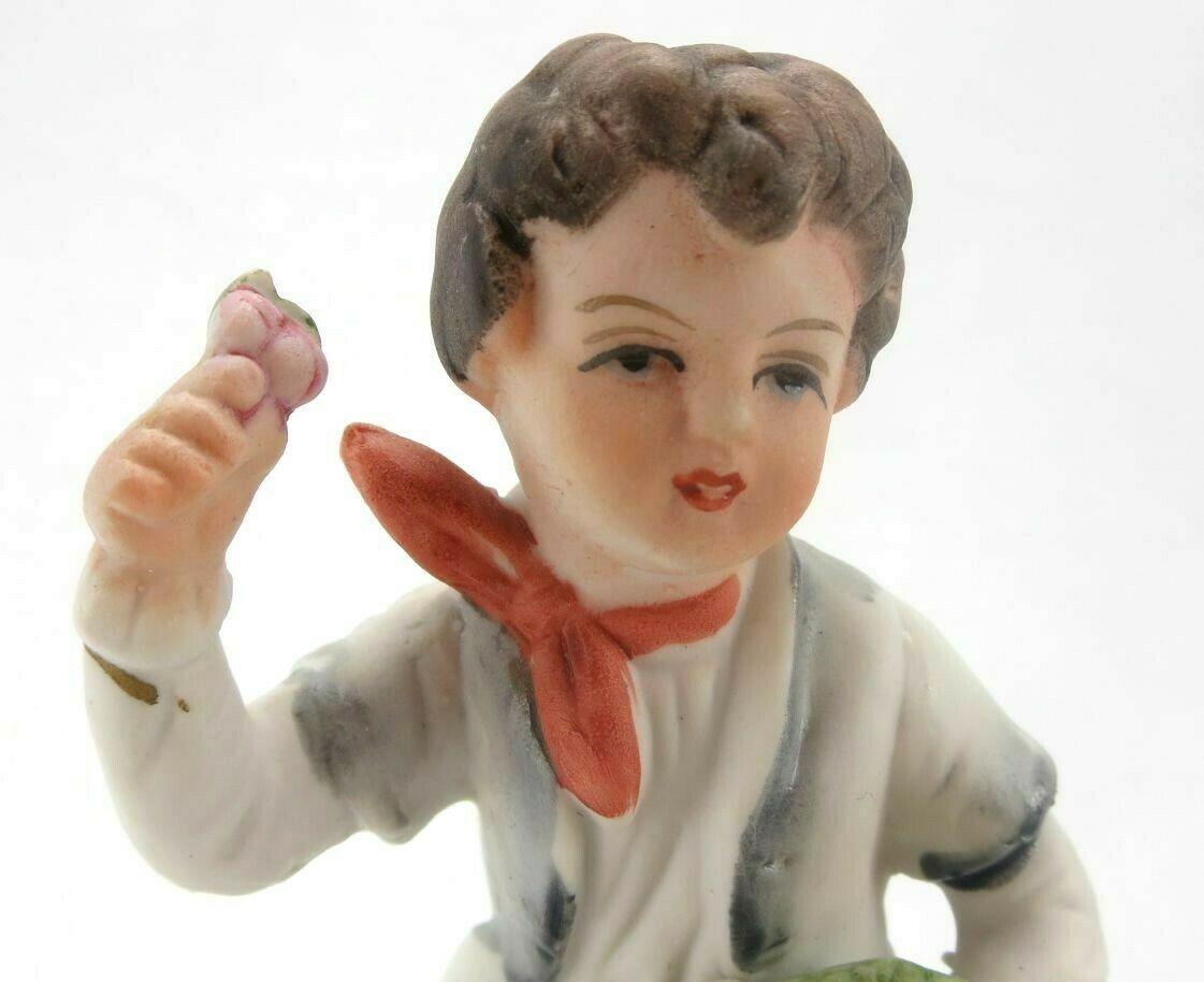 Porcelain Figurine Ucagco Boy with Flowers