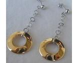 Dangling golden rings earrings thumb155 crop