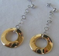 Dangling golden rings earrings - $30.00