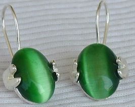 Green oval earrings - $25.00