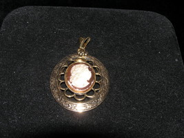 Vintage Brown & Cream Plastic Cameo in Oval Ornate Goldtone Frame Pendant - $7.69