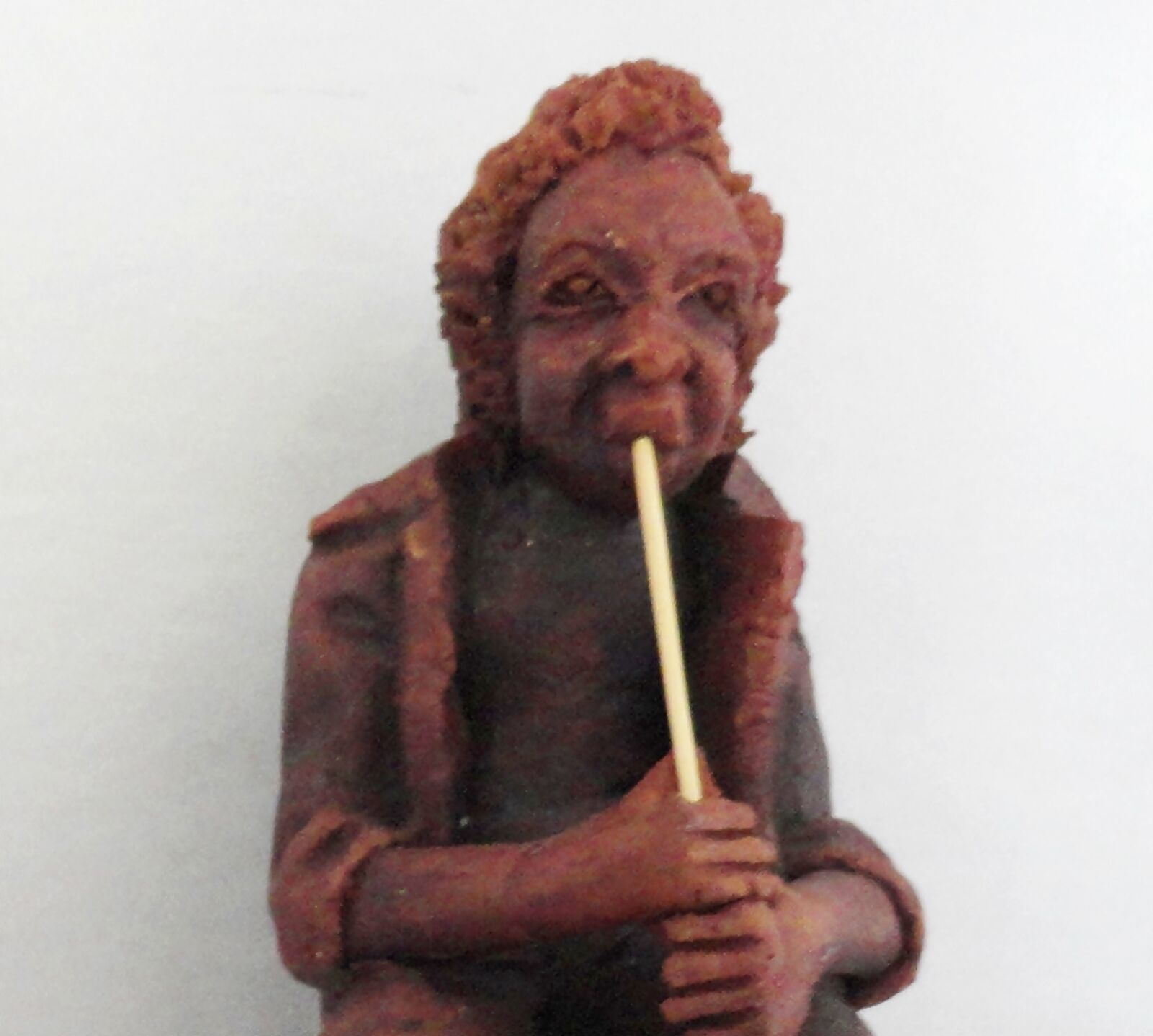 Folk Art Red Clay Figurine of Musician Playing a Wind Pipe