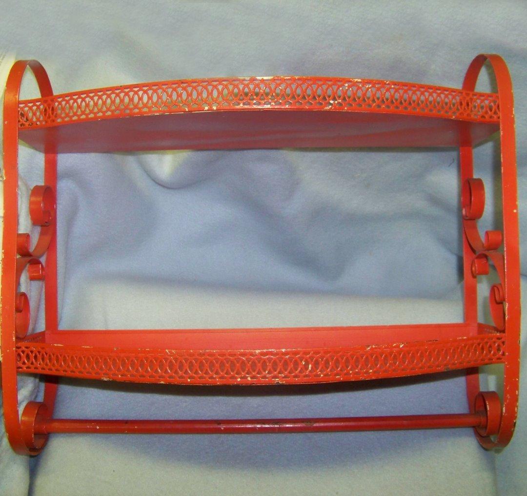 vintage 40s bright orange tin shelf with towel rack