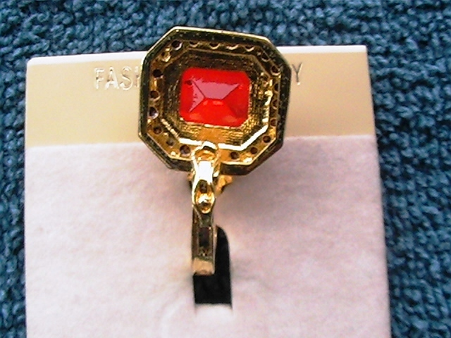 Red solitare with rhinestone encircled pendant