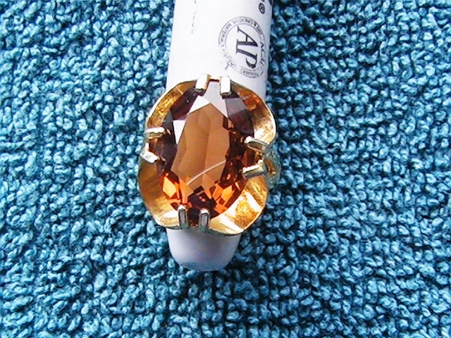 Vintage cocktail ring with orange/brown stone