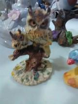 4 Songbird Figurines and an Owl Figure - $7.31