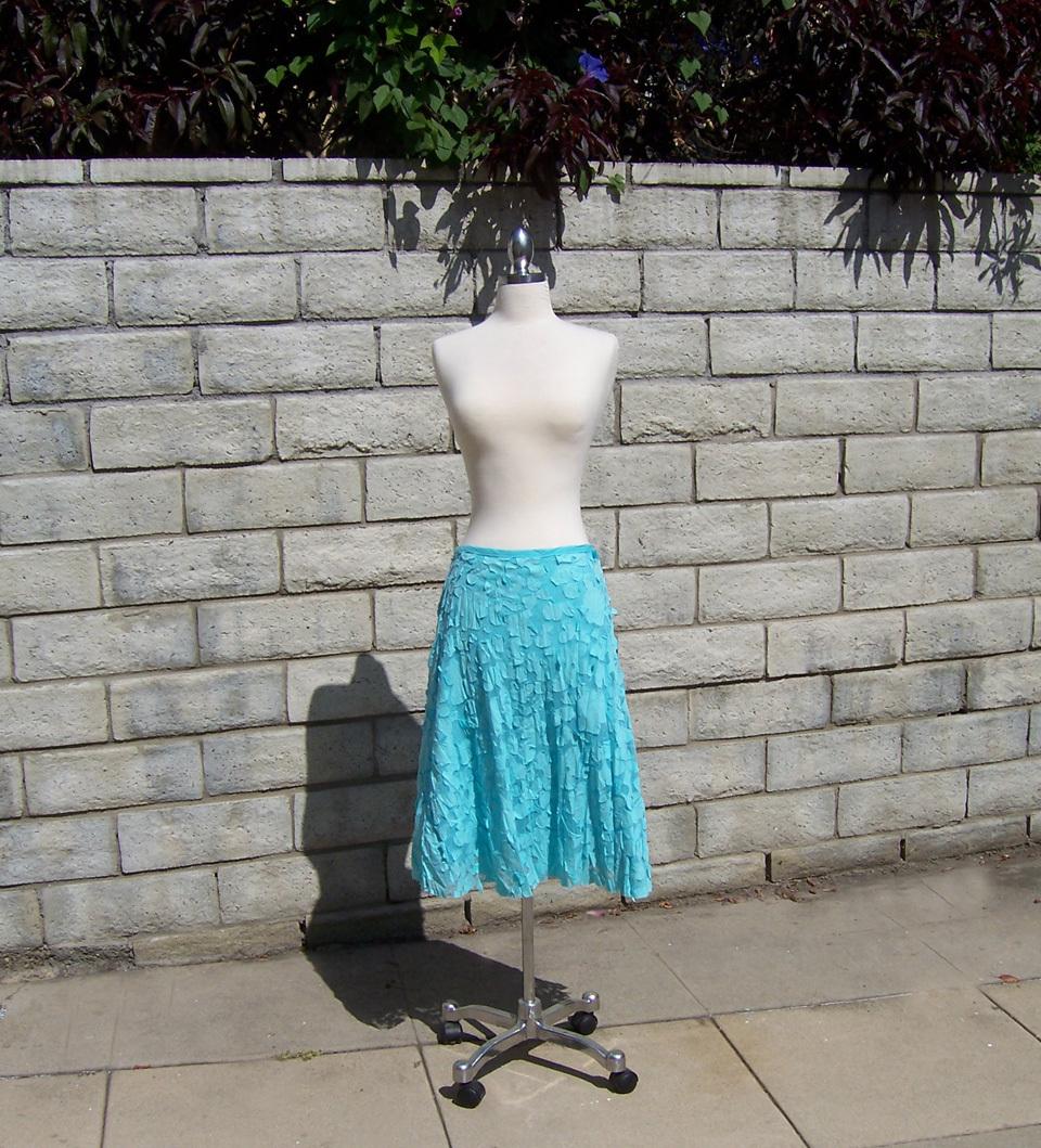 sky blue net skirt w blue appliqué flowers and petals - L
