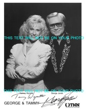 An item in the Entertainment Memorabilia category: TAMMY WYNETTE AND GEORGE JONES AUTOGRAPHED PROMOTIONAL 8X10 PHOTO