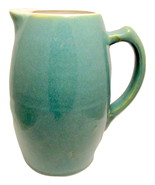 Heavy turquoise pottery pitcher 1 thumbtall