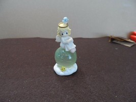 Precious Moments Angel on the world ornament 2004 - $7.95