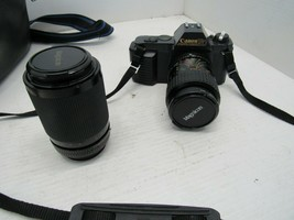 Canon T50 35mm Camera with Two Lenses & Case & Original Instruction Manuals - $49.49