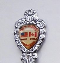 Collector Souvenir Spoon USA Canada Peace Garden Flags Emblem - $2.99