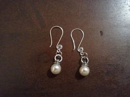 Silver and pearl earrings medium - $7.00
