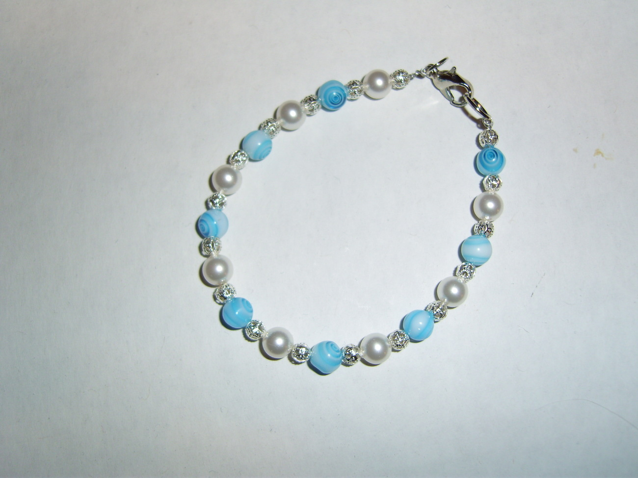 Handmade blue and white millefiori beaded silver bracelet