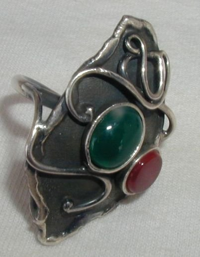 Black silver ring with red and green stones
