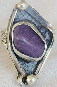 Purple glass ring sr95
