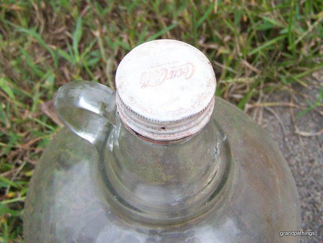 Antique coca cola gallon syrup glass jug with lid