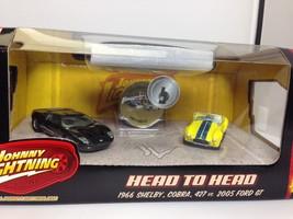 Johnny Lightning 1/64 Head to Head 2 car set 1966 Shelby Cobra 427 2005 ... - $14.95