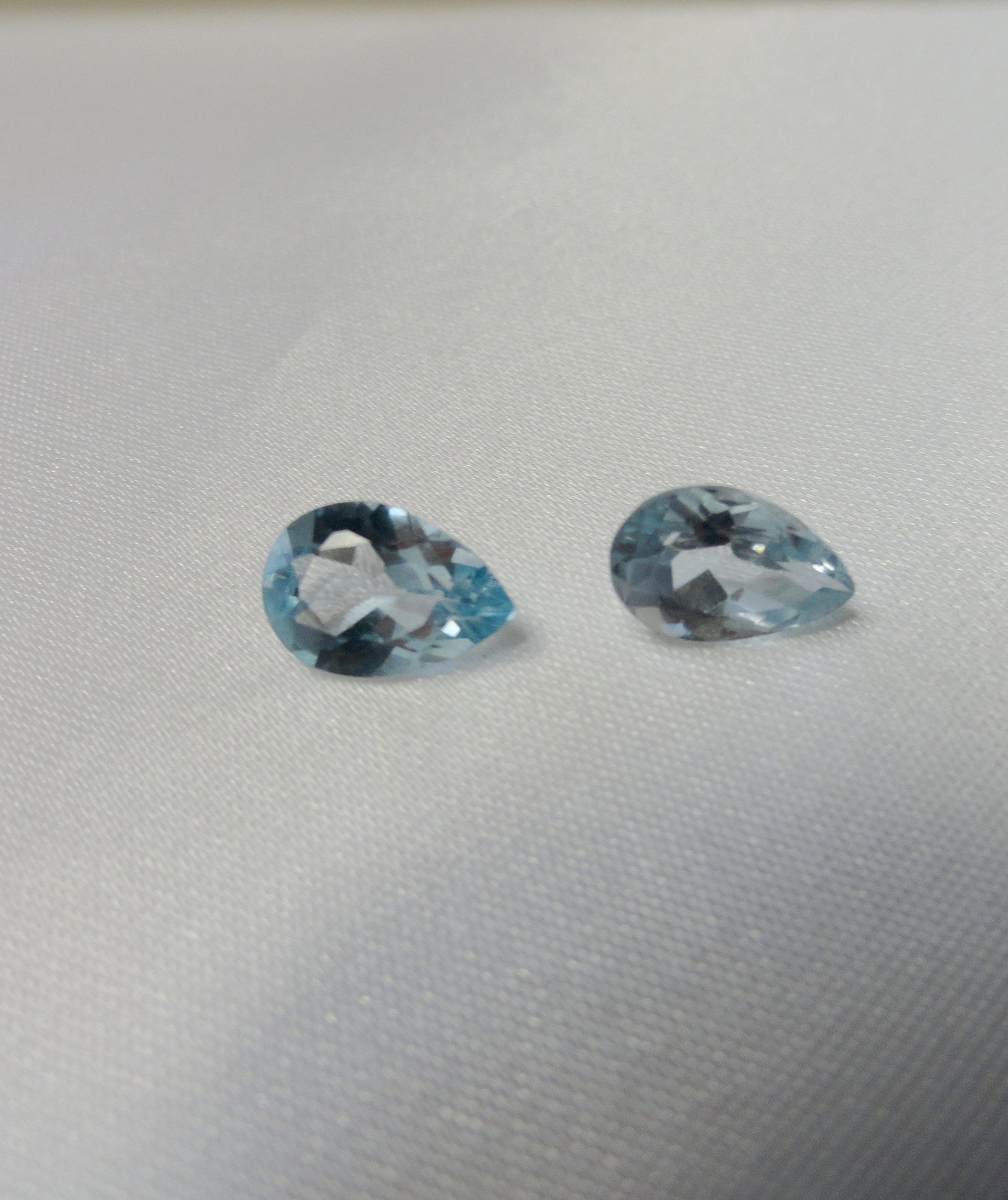 Icy Blue 6.24 Ctw Genuine  Blue Topaz Pear Set (2) 10X7mm New