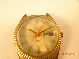 1975 CARAVELLE DAY DATE AUTOMATIC WATCH RUNS AND STOPS FOR REPAIR OR PARTS - $95.00