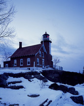 Eagle Harbor Light lighthouse in Michigan after a snowfall Photo Print - $7.05+
