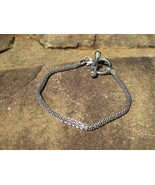 Free cleansing recharging toggle bracelet with 50.00 or more purchase - $0.00