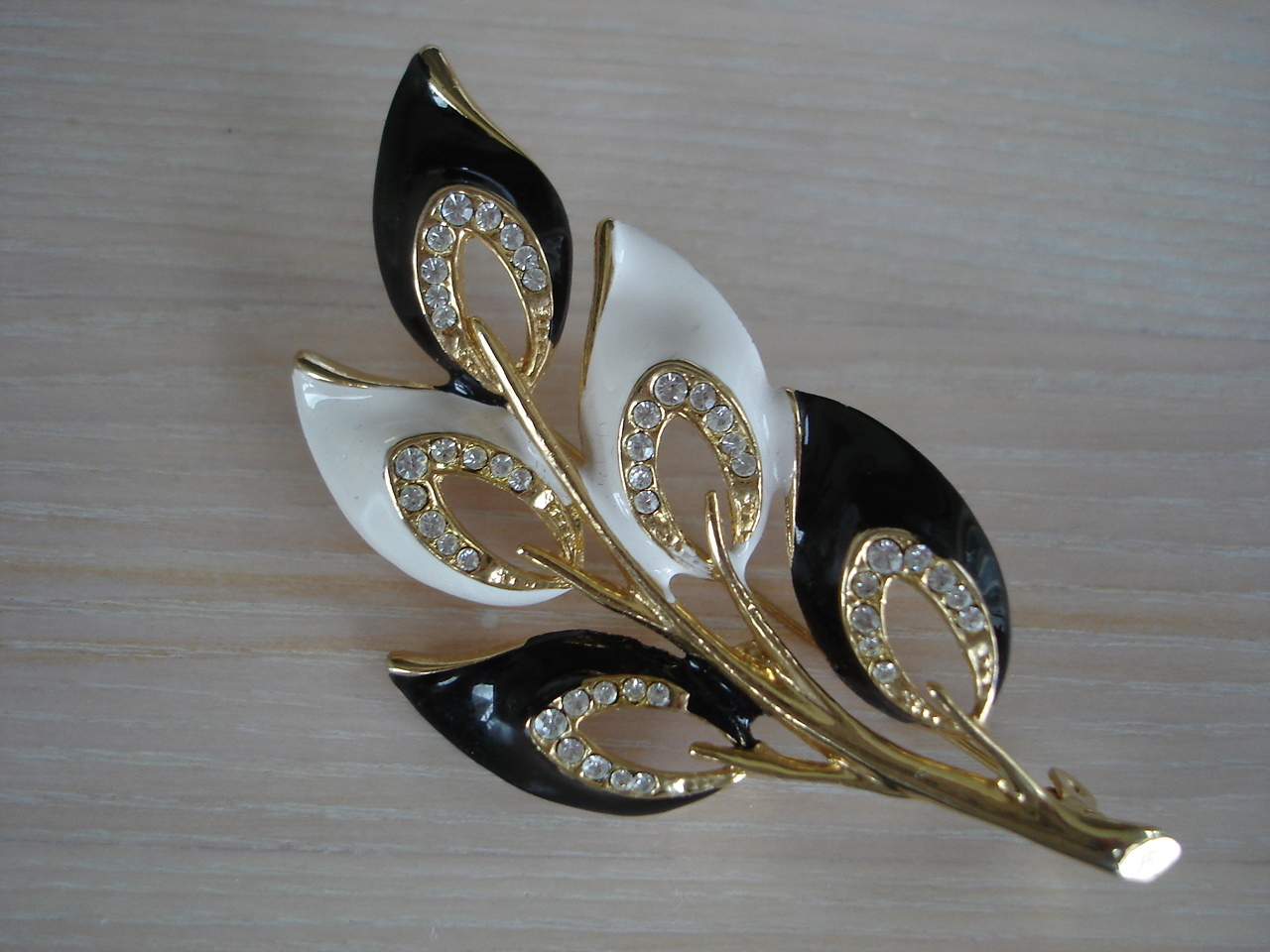 Goldtone Black/White Enameled Leaf Brooch, Clear Rhinestones