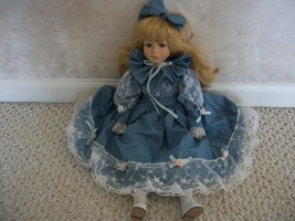 Doll dressed in a Very Pretty Blue Dress adorned with lace and ruffles.... - $57.99