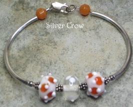 White & Orange Lamp Work Sterling Silver Bangle Bracelet - $27.99