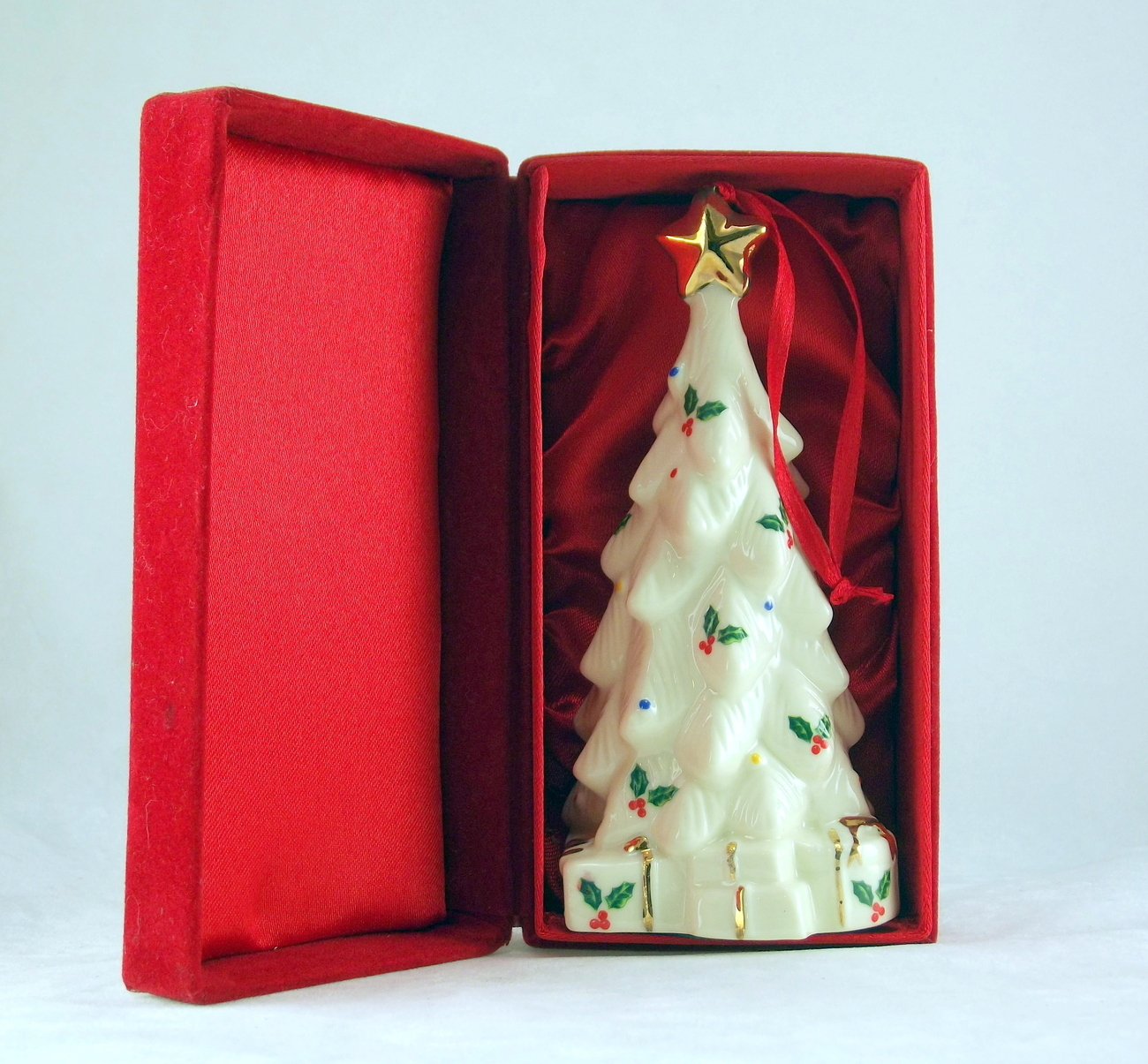 Madison and Max porcelain Christmas Tree ornament in red flocked box