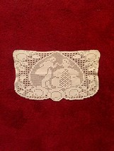 Vintage rectangular doily with Victorian dancers and intricate border detail.