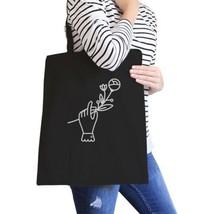 Hand Holding Flower Black Cotton Canvas Bag School Bag Craft Bag - $15.99