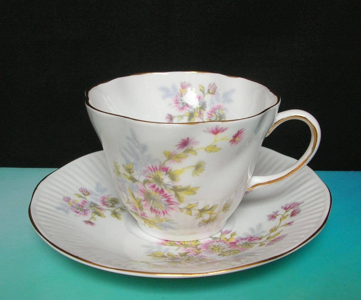 Primary image for Vintage QUEENS ROSINA Bone China TEA CUP & SAUCER Pink Yellow Floral Scalloped