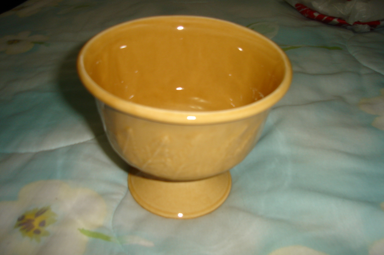 Yellow pottery vase