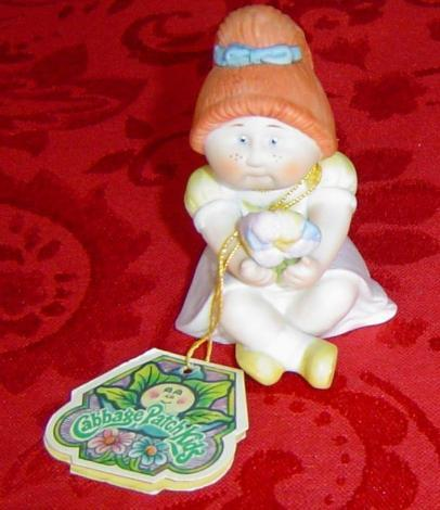 Cabbage Patch Kids Porcelain red head girl holding flowers