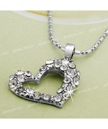 Sparkles for the Holidays Lovely Heart shaped necklace... - $10.00