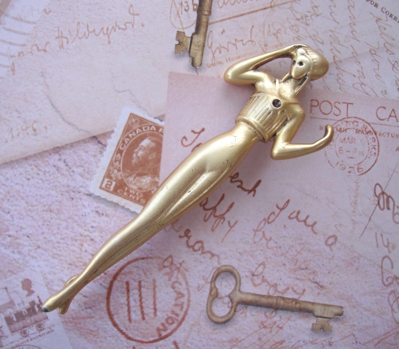 Art Deco Style Goldtone Pin in the Shape of a Standing Woman