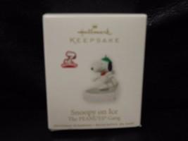 """Hallmark Keepsake """"Snoopy On Ice - Peanuts"""" 2010 Miniature Ornament NEW   - $24.50"""