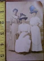 Three ladies with hats  1 thumb200