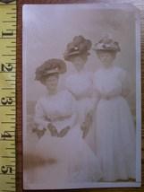 Three hat ladies  1 thumb200