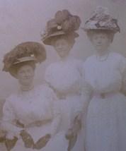 Three hat ladies  2 thumb200